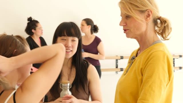 multi-ethnic females discussing in dance studio - black hair stock videos & royalty-free footage