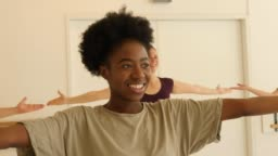 Multi-ethnic females learning dance in health club