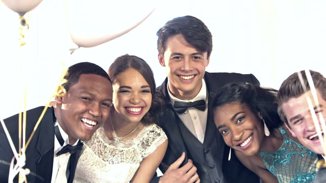 multi-ethnic friends at prom posing for photos - high school prom stock videos and b-roll footage