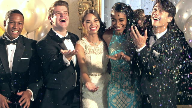 multi-ethnic friends at prom, showered with confetti - formal stock videos and b-roll footage