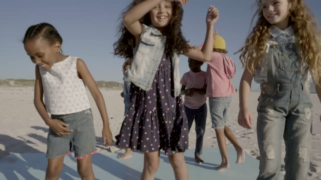 multi-ethnic friends dancing at beach against sky - day stock videos & royalty-free footage