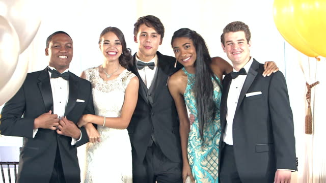 multi-ethnic friends dressed for prom posing for photos - high school prom stock videos and b-roll footage