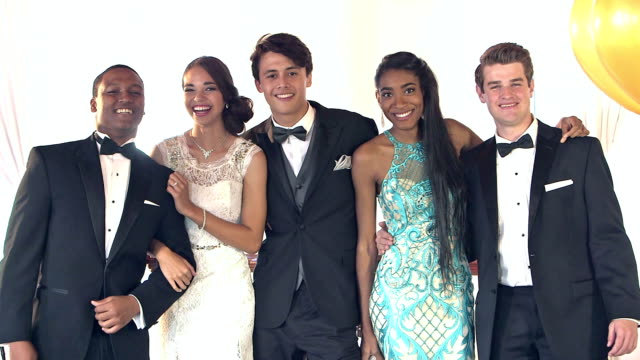Multi-ethnic friends dressed for the prom