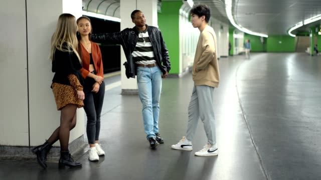 multi-ethnic friends waiting for a train - quartet stock videos & royalty-free footage