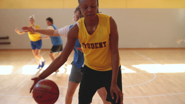 multi-ethnic girls in action on basketball game - shooting baskets stock videos & royalty-free footage