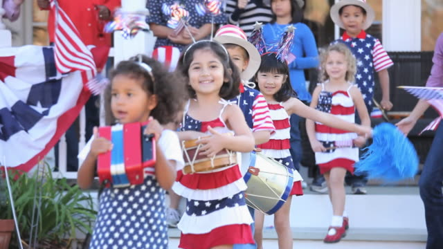 ms multi-ethnic group celebrating independence day, children walking in parade in back yard / richmond, virginia, usa - parade stock videos & royalty-free footage