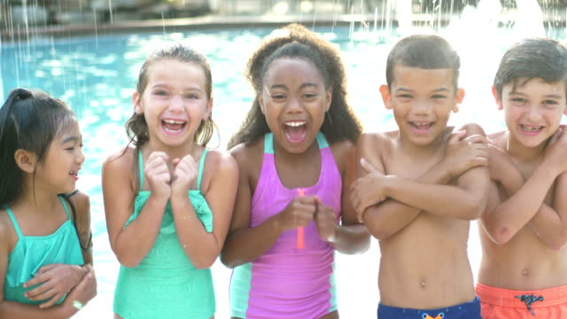 multi-ethnic group of children by swimming pool - shivering stock videos & royalty-free footage