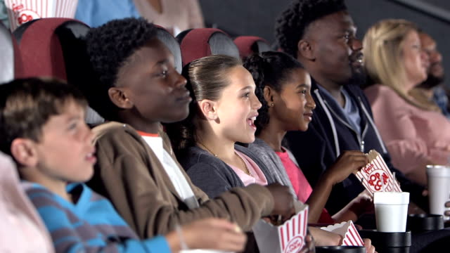 multi-ethnic group of children in movie theater - film industry stock videos & royalty-free footage