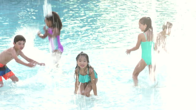multi-ethnic group of children standing in swimming pool - fountain stock videos & royalty-free footage