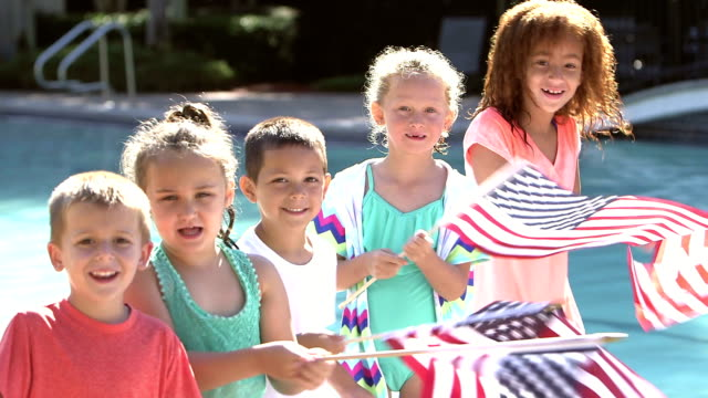multi-ethnic group of children waving american flags - 4 5 years stock videos and b-roll footage