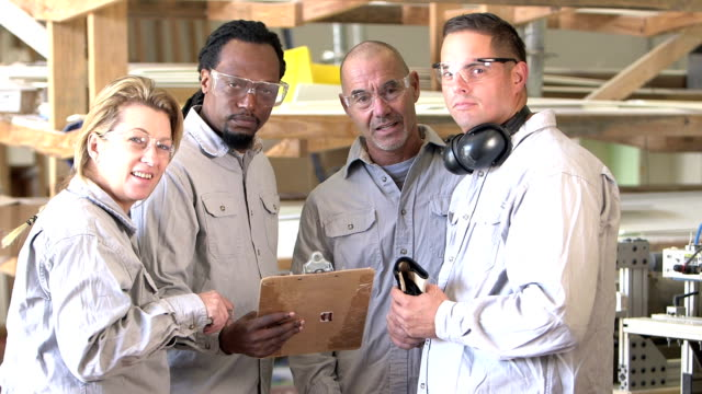 multi-ethnic group of factory workers with clipboard - minority groups stock videos and b-roll footage