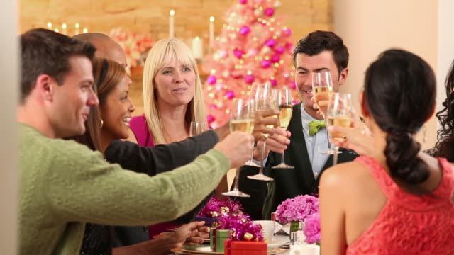 Multi-ethnic group of friends celebrating Christmas.