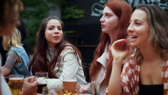 multi-ethnic group of friends gathering in outdoor pub in buenos aires - pierced stock videos & royalty-free footage