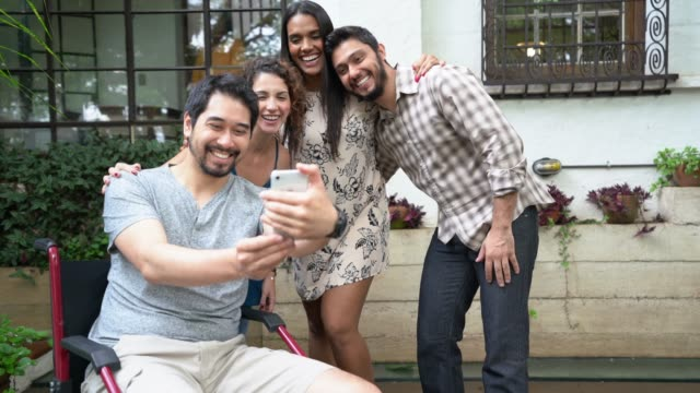 multi-ethnic group of friends taking a selfie at home - attività del fine settimana video stock e b–roll