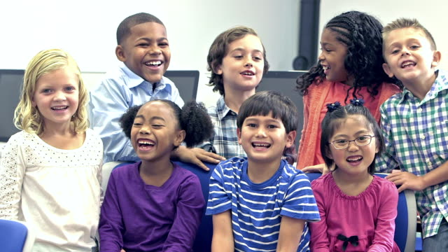 multi-ethnic group of happy elementary school children - elementary student stock videos & royalty-free footage