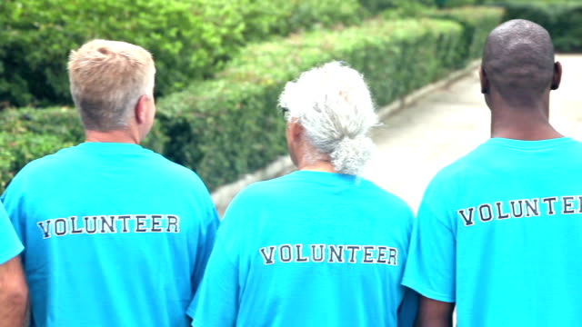 multi-ethnic group of men, volunteers - t shirt stock videos & royalty-free footage
