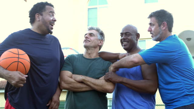 multi-ethnic group of middle aged men playing basketball - 40 49 years stock videos & royalty-free footage