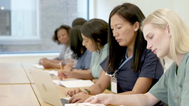 multi-ethnic group of nursing students in class - scrubs stock videos & royalty-free footage