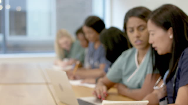 multi-ethnic group of nursing students in class - medical scrubs stock videos & royalty-free footage
