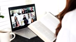 Multi-ethnic group of people participate in online Bible study during COVID-19 pandemic