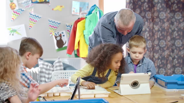 Multi-ethnic group of school children at lesson