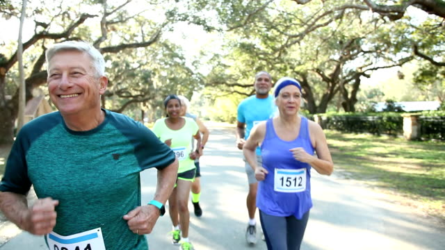 multi-ethnic group of seniors running in a race - five people stock videos & royalty-free footage