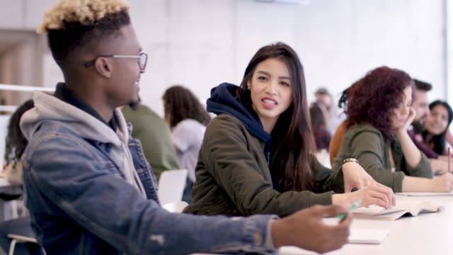 a multi-ethnic group of students work together in the university student study hall. - university stock videos & royalty-free footage