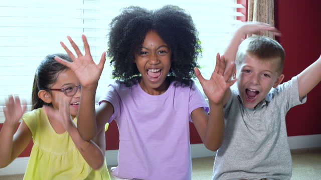 multi-ethnic group of three children shouting and waving - 8 9 years stock videos & royalty-free footage