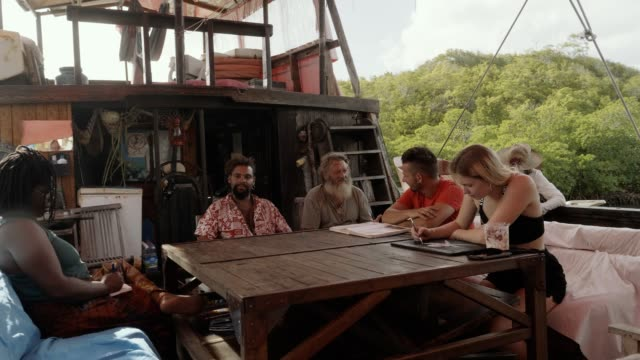 stockvideo's en b-roll-footage met a multiethnic group of travelers on a historic ship in the caribbean - french overseas territory