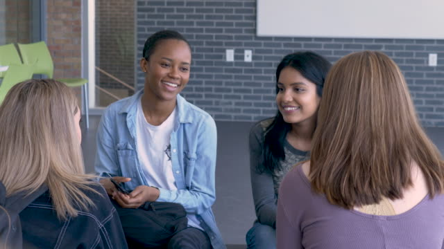 multi-ethnic group of university hanging out - multi ethnic group stock-videos und b-roll-filmmaterial