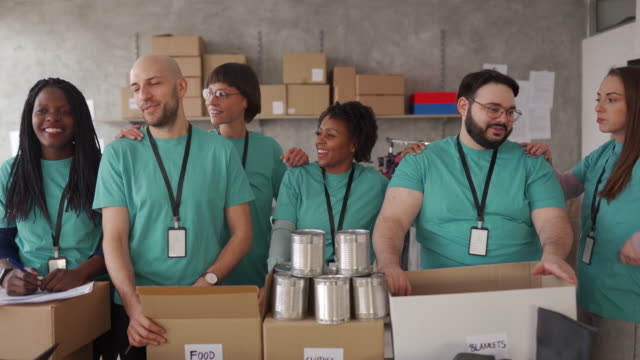 multi-ethnic group of volunteers are happy about work they've done - togetherness stock videos & royalty-free footage