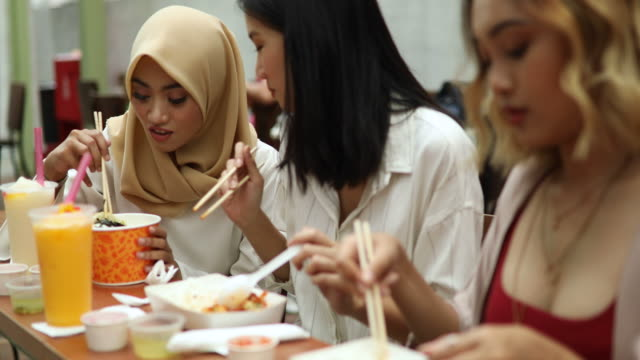 multi-ethnic group of women eating with chopsticks - customs stock videos & royalty-free footage