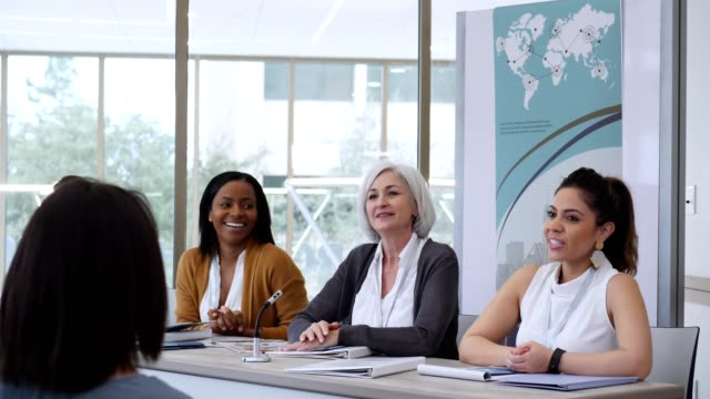 multi-ethnic group of women participate in panel discussion - panel discussion stock videos & royalty-free footage