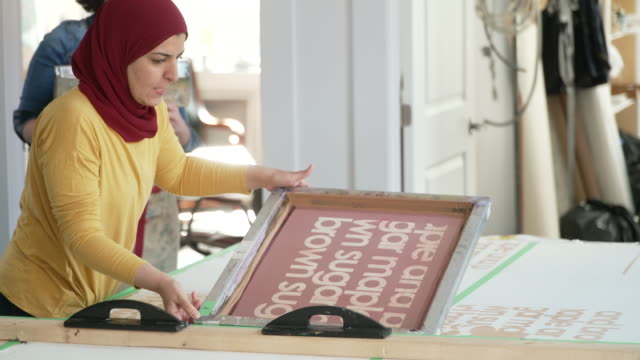 multi-ethnic group of women screen printing in a shared studio space - art stock videos & royalty-free footage