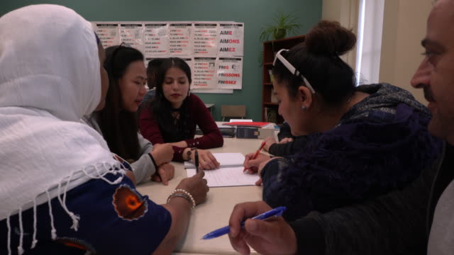 multi-ethnic group portrait adult school inside class teamworking - emigration and immigration stock videos & royalty-free footage