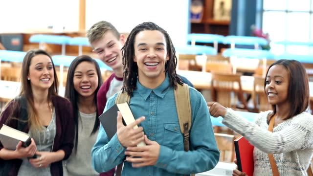 multi-ethnic high school students in library being silly - admiration stock videos and b-roll footage