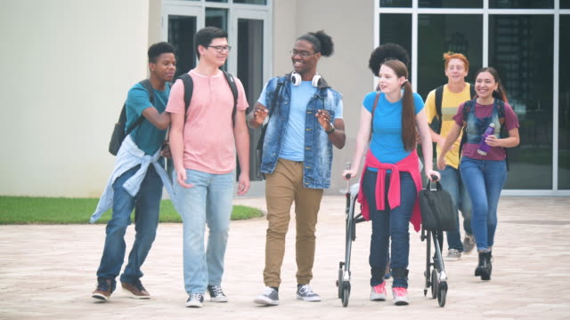 multi-ethnic high school students walking and talking - 14 15 years stock videos & royalty-free footage