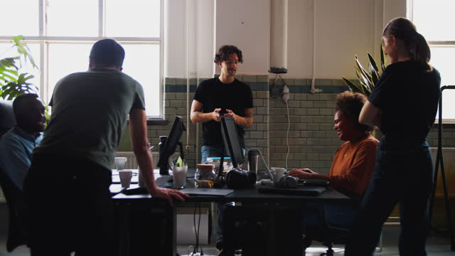 multi-ethnic male and female computer programmers working at coworking space - medarbetarengagemang bildbanksvideor och videomaterial från bakom kulisserna