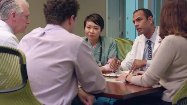 multi-ethnic medical professionals meet in office - ms - medical leadership stock videos & royalty-free footage
