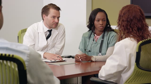 multi-ethnic medical team meeting in a modern office - ms - hospital leadership stock videos & royalty-free footage
