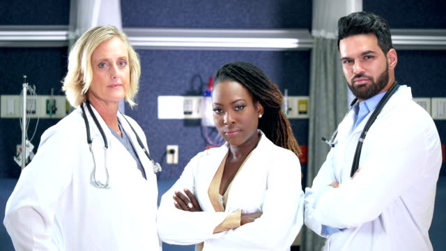 multi-ethnic medical team - laboratory coat stock videos & royalty-free footage