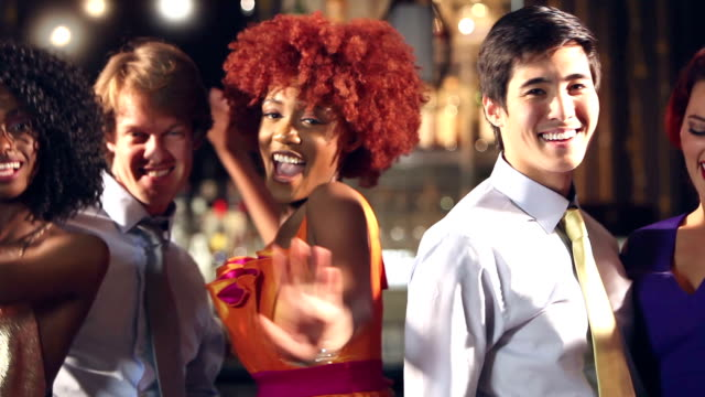 multi-ethnic men and women dancing at bar - party social event stock videos and b-roll footage