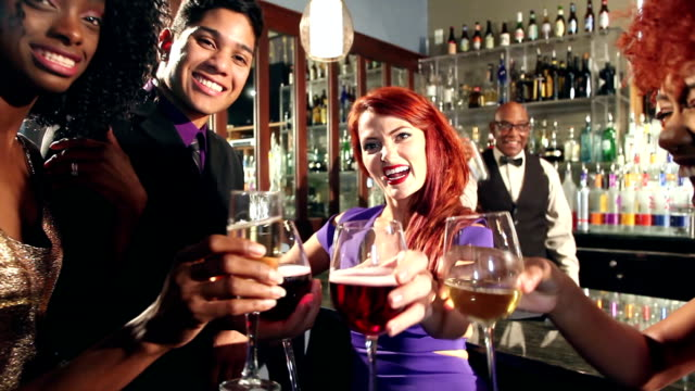 multi-ethnic men and women having fun drinking at bar - party social event stock videos and b-roll footage