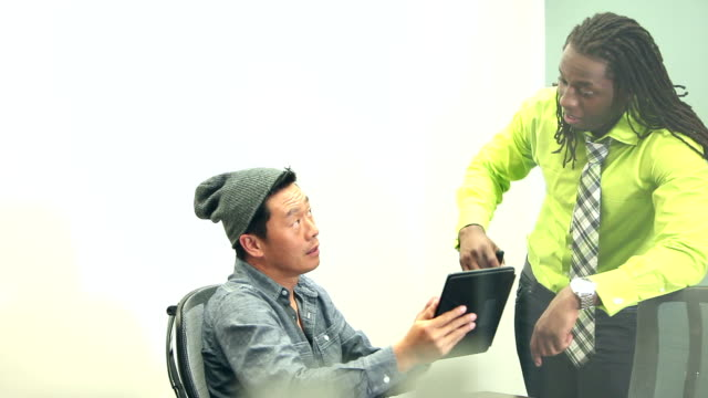 multi-ethnic men discussing business strategy - woolly hat stock videos & royalty-free footage