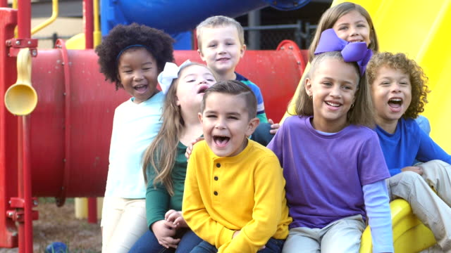 multi-ethnic preschool children on playground - disability inclusion stock videos & royalty-free footage
