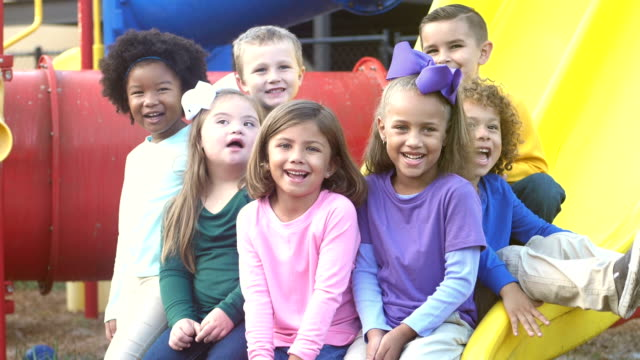 multi-ethnic preschool children on playground - nursery school child stock videos & royalty-free footage