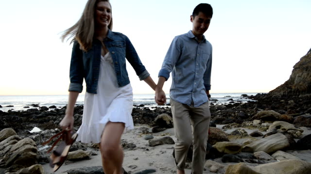 Multi-Ethnic Romantic Couple Walking at the Beach