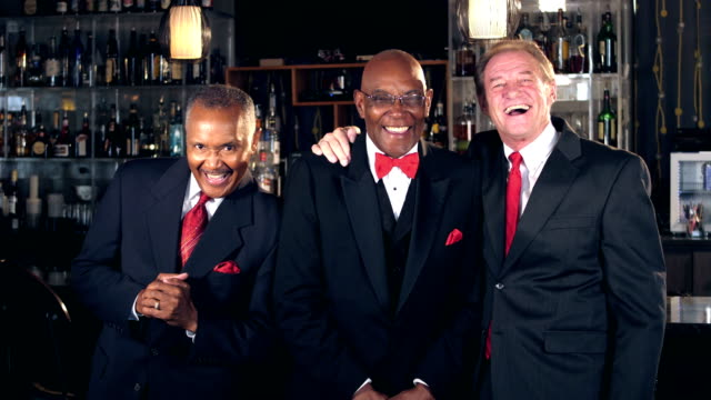 multi-ethnic senior men at bar wearing suits, laughing - three people stock videos & royalty-free footage