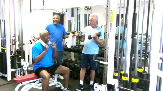 multi-ethnic senior men talking at the gym - 60 69 years stock videos and b-roll footage