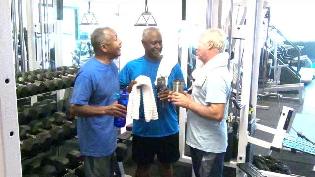 Multi-ethnic senior men talking at the gym